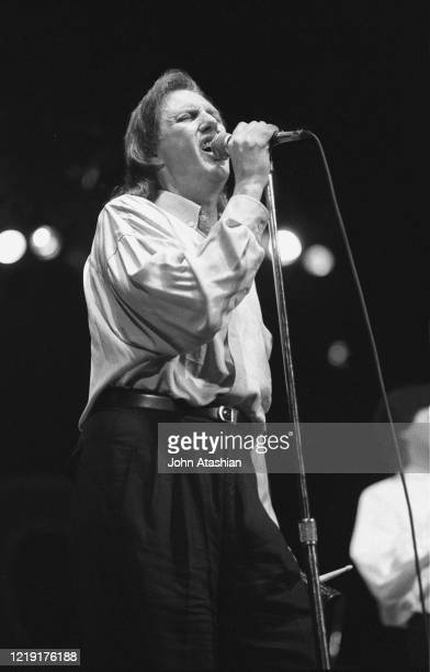 """Singer Cory Wells is shown performing on stage during a """"live"""" concert appearance with Three Dog Night on July 26, 1987."""