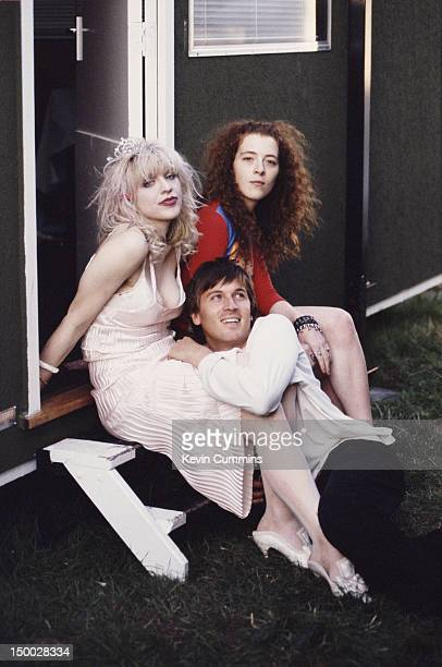 Singer Courtney Love and bassist Melissa Auf der Maur, of rock group Hole, with singer-songwriter Evan Dando of The Lemonheads backstage at Reading...