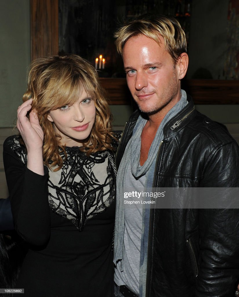 Singer Courtney Love and Daniel Benedict attend the Cinema Society & Laura Mercier host the after party for 'Conviction' at Soho Grand Hotel on October 12, 2010 in New York City.