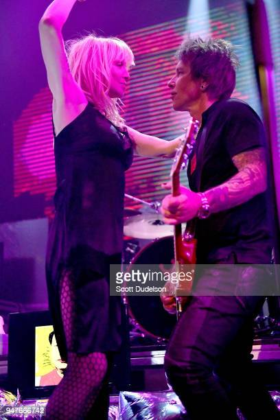 Singer Courtney Love and Guitarist Billy Morrison perform onstage during the Above Ground concert benefiting MusiCares at Belasco Theatre on April 16...