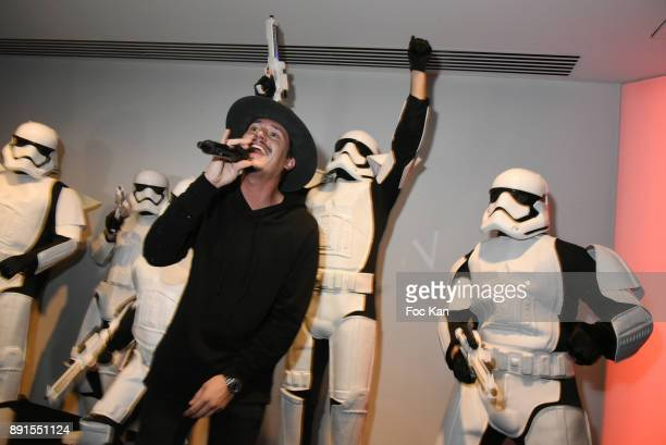 Singer Cris Cab and dancers in Storm Trooper suits performs during the Star Wars Party at Le Saint Fiacre on December 12 2017 in Paris France