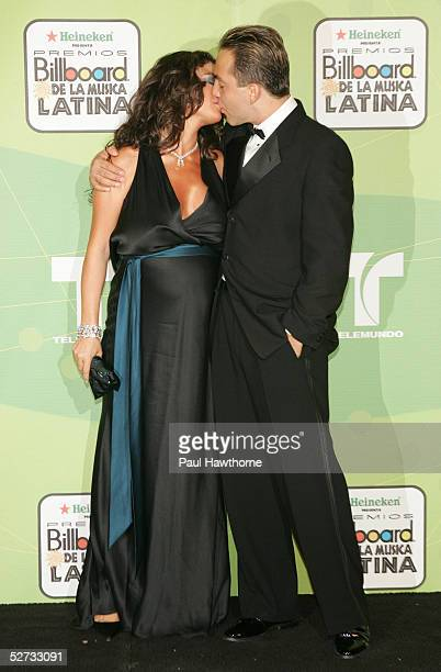 Singer Cristian Castro poses with his wife Valeria Liberman backstage at 2005 Billboard Latin Music Awards at the Miami Arena April 28 2005 in Miami...