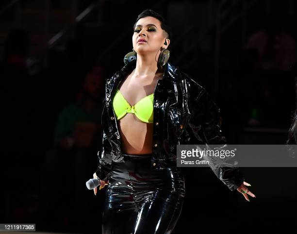 Singer CRISTNA performs during halftime at New York Knicks vs Atlanta Hawks game at State Farm Arena on March 11 2020 in Atlanta Georgia