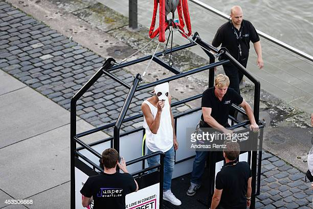 Singer Cro standing in a crane basket prior to the Telekom Street Gigs on August 7 2014 in Cologne Germany