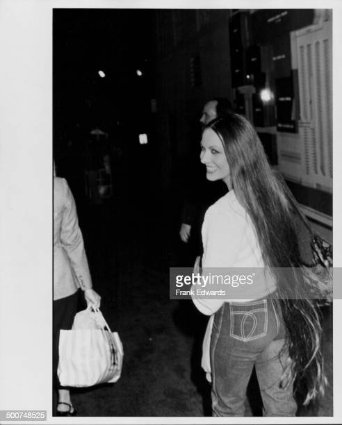 Singer Crystal Gayle smiling as she attends the American Music Awards Hollywood California January 1981