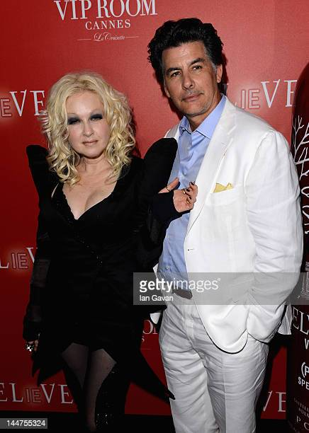 Singer Cyndi Lauper and David Thornton arrive at The RED Party in Cannes featuring Cyndi Lauper at VIP Rooms at The JW Marriott on May 18 2012 in...