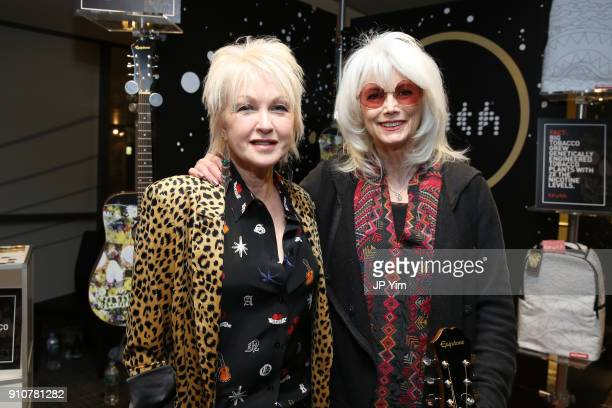 Singer Cyndi Lauper and singersongwriter Emmylou Harris attend the GRAMMY Gift Lounge during the 60th Annual GRAMMY Awards at Madison Square Garden...