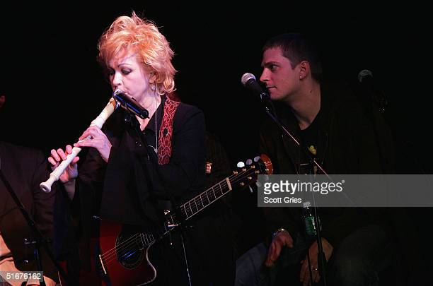Singer Cyndi Lauper performs with Rob Thomas of Matchbox Twenty at the VH1 Save The Music Presents Songwriters In The Round Generations 3 The Best of...