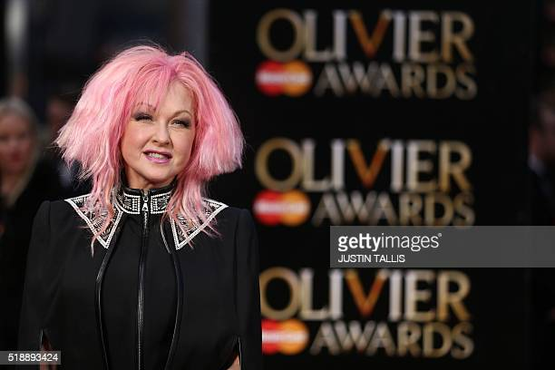 US singer Cyndi Lauper poses on the red carpet upon arrival to attend the 2016 Laurence Olivier Awards in London on April 3 2016 / AFP / JUSTIN TALLIS