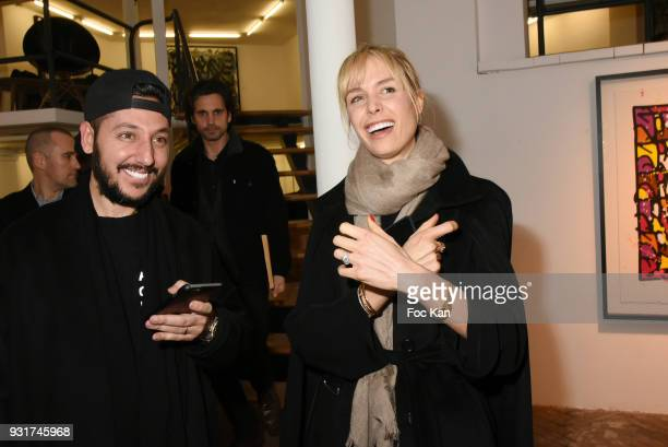 Singer Cyril Kamar and his wife Anne Sophie Kamar attend ÔBirth of The WindÕ JonOne Preview at Galerie Brugier Rigail on March 13 2018 in Paris France