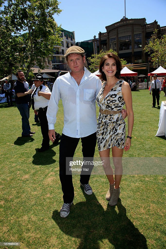 Singer D. Henry Fenton (L) and actress Teri Hatcher attend celebrity yard sale and auction benefitting Juvenile Arthritis Association at The Americana at Brand on April 27, 2013 in Glendale, California.