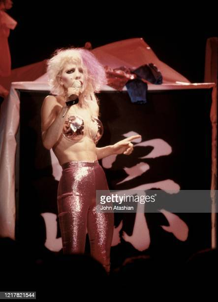 Singer Dale Bozzio is shown performing on stage during a live concert appearance with Missing Persons on February 1 1982