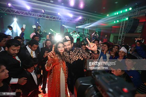 singer Daler Mehndi's daughter Ajit Kaur with Navraj Singh son of singer Hans Raj Hans during their pre wedding party on November 6 2013 in New Delhi...