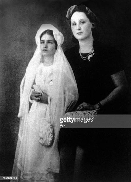 Singer Dalida, young, with her godmother the day of her first communion june 8 Cairo