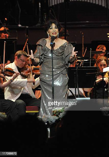 Singer Dame Shirley Bassey performs on stage during the John Barry Memorial Concert at the Royal Albert Hall on June 20 2011 in London England