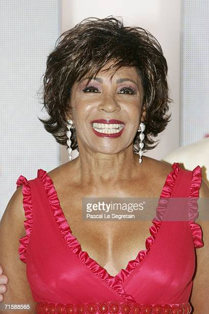 Singer Dame Shirley Bassey poses at the Monaco Red Cross Ball under the Presidency of HSH Prince Albert II in the Salles des Etoiles at the Sporting...