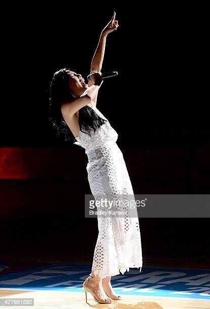 Singer Dami Im performs for fans before the 2015 ANZ Championship Grand Final match between the Firebirds and the Swifts at Brisbane Entertainment...