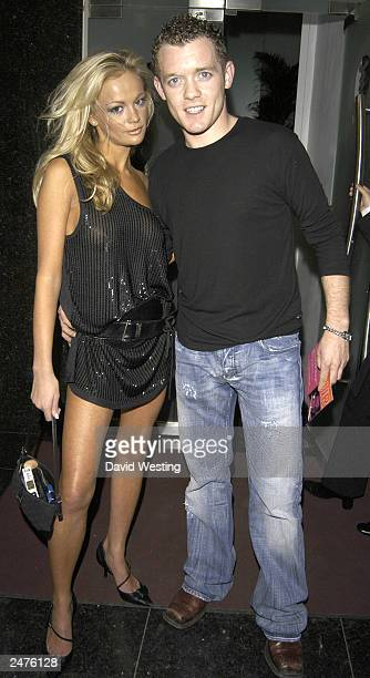 Singer Damien from band DSide poses with his girlfriend model Nicola Ulian as they leave the National Glamour Day Party at Tantra on September 8 2003...