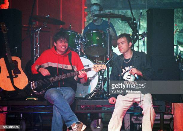 Singer Damon Albarn bass guitarist Alex James and drummer Dave Rowntree of the pop band Blur performing on stage at the inaugral BBC Two Awards held...