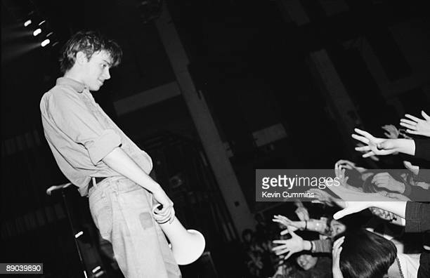 Singer Damon Albarn performing with English pop group Blur Tokyo March 1992