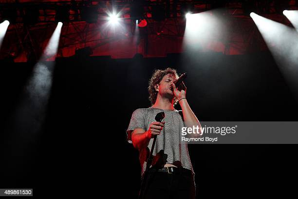 Singer Dan Reynolds from Imagine Dragons performs at FirstMerit Bank Pavilion at Northerly Island during 'Farm Aid 30' on September 19 2015 in...