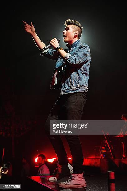 Singer Dan Smith of Bastille performs on stage at KeyArena on November 25 2014 in Seattle Washington