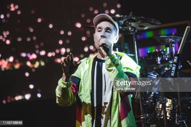 Singer Dan Smith of the English band Bastille performs live during the 360 degree HD live stream concert as part of the Telekom Street Gigs at Hangar...