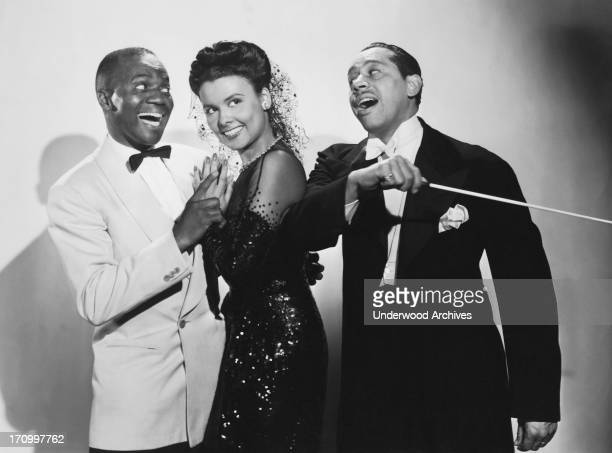 Singer dancer and actress Lena Horne with Bill 'Bojangles' Robinson and Cab Calloway in the musical film 'Stormy Weather' Hollywood California 1943