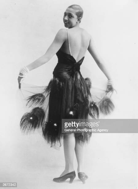Singer dancer and entertainer Josephine Baker wearing a dress decorated with feathers