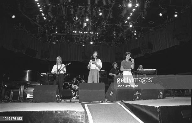 """Singer Danny Hutton and Cory Wells are shown performing on stage during a """"live"""" concert appearance with Three Dog Night on July 26, 1987."""