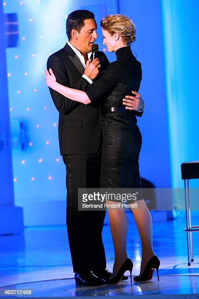 Singer Dany Briillant and Main Guest of the show Actress Alexandra Lamy perform during the 'Vivement Dimanche' French TV Show Held at Pavillon...