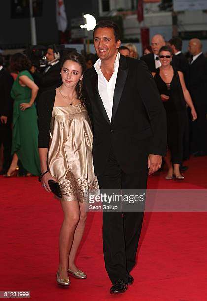 Singer Dany Brillant and daughetr arrive at the Palermo Shooting premiere at the Palais des Festivals during the 61st International Cannes Film...
