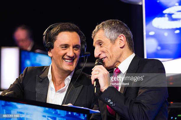 Singer Dany Brillant and presenter Nagui attend the 'France Television Telethon 2014' TV show on December 6 2014 in Paris France
