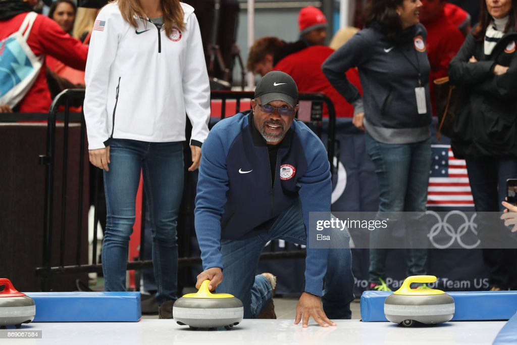 Singer Darius Rucker curls as part of festivities during the 100 Days Out 2018 PyeongChang Winter Olympics Celebration - Team USA in Times Square on November 1, 2017 in New York City.