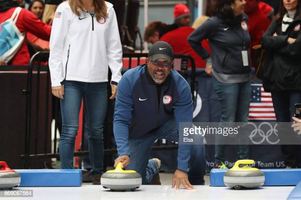 Singer Darius Rucker curls as part of festivities during the 100 Days Out 2018 PyeongChang Winter Olympics Celebration Team USA in Times Square on...