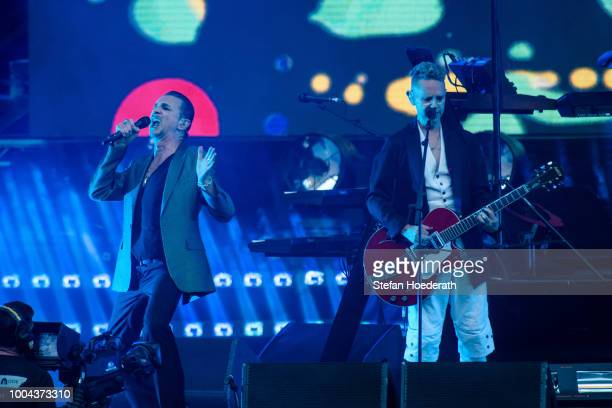 Singer Dave Gahan and guitarist Martin Gore of Depeche Mode perform live on stage during a concert at Waldbuehne on July 23 2018 in Berlin Germany