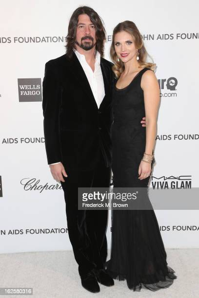 Singer Dave Grohl and Jordyn Blum arrives at the 21st Annual Elton John AIDS Foundation's Oscar Viewing Party on February 24 2013 in Los Angeles...