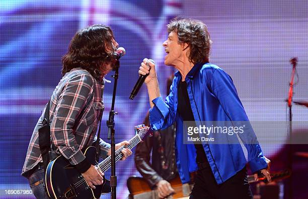 Singer Dave Grohl and Mick Jagger perform at the 'Rolling Stones 50 Counting Tour' at The Honda Center on May 15 2013 in Anaheim California