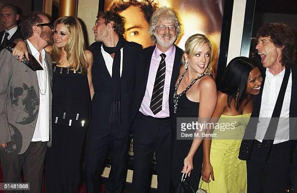 Singer Dave Stewart actress Sienna Miller actor Jude Law director Charles Shyer actress Jane Krakowski actress Nia Long and singer Mick Jagger arrive...