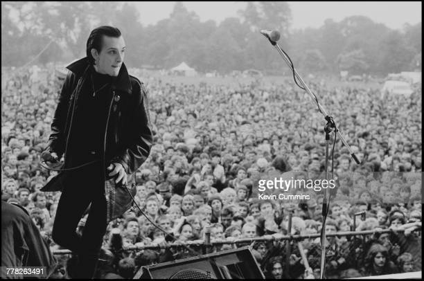 Singer Dave Vanian performing with British punk band The Damned at the Northern Carnival Against Missiles a festival in aid of CND held in Alexandra...