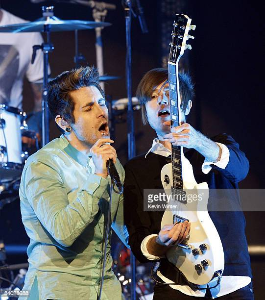 Singer Davey Havok and musician Jade Puget of AFI perform at KROQ's Almost Acoustic Xmas at the Gibson Amphitheatre on December 13, 2008 in Universal...