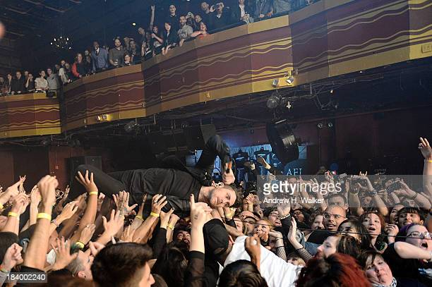 Singer Davey Havok of the band AFI jumps into the audience at Webster Hall on October 10 2013 in New York City