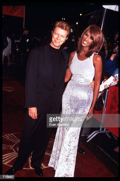 Singer David Bowie and his wife Iman arrive at the Essence Awards April 26 1996 in New York City The ceremony honors AfricanAmericans who represent...