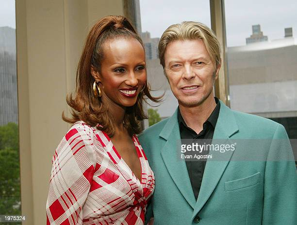 Singer David Bowie and his wife model Iman stand backstage at The Film Society of Lincoln Center's Tribute to Susan Sarandon at Avery Fisher Hall May...