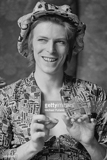 Singer David Bowie being interviewed at his ground floor flat at Haddon Hall, where he has been redecorating the ceiling in silver paint, Beckenham,...