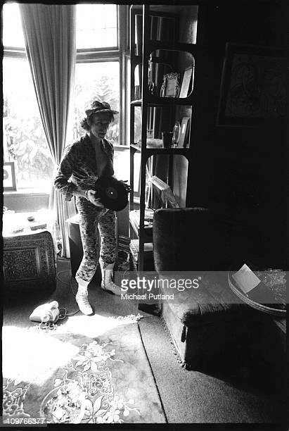 Singer David Bowie holding an LP at his ground floor flat at Haddon Hall where he has been redecorating the ceiling in silver paint Beckenham London...