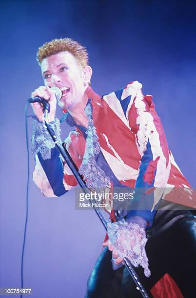 Singer David Bowie performs on stage wearing a Union Jack jacket at the Phoenix Festival held at Long Marston Airfield near StratfordUpon Avon on...