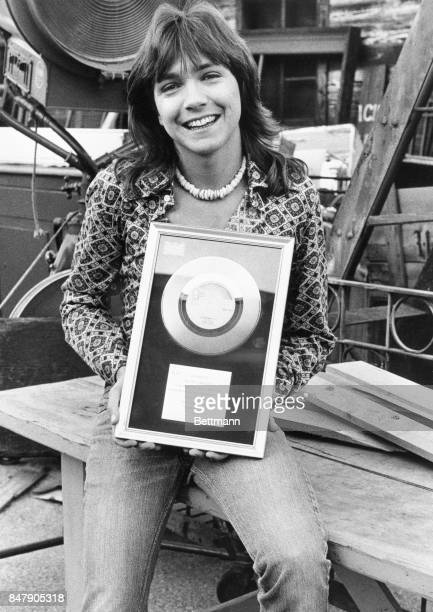 """Singer David Cassidy displays his latest Silver Disc award from the United Kingdom, earned when his new record, """"Daydreamer"""" achieved sales in excess..."""