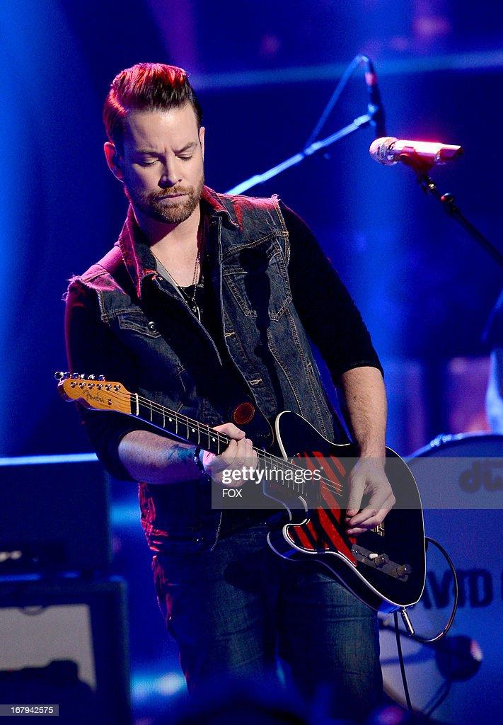 "Singer David Cook performs onstage at FOX's ""American Idol ..."