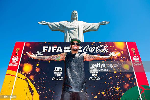 Singer David Correy poses during the official launch of the Global FIFA World Cup Trophy Tour in front of the statue of Christ the Redeemer on...
